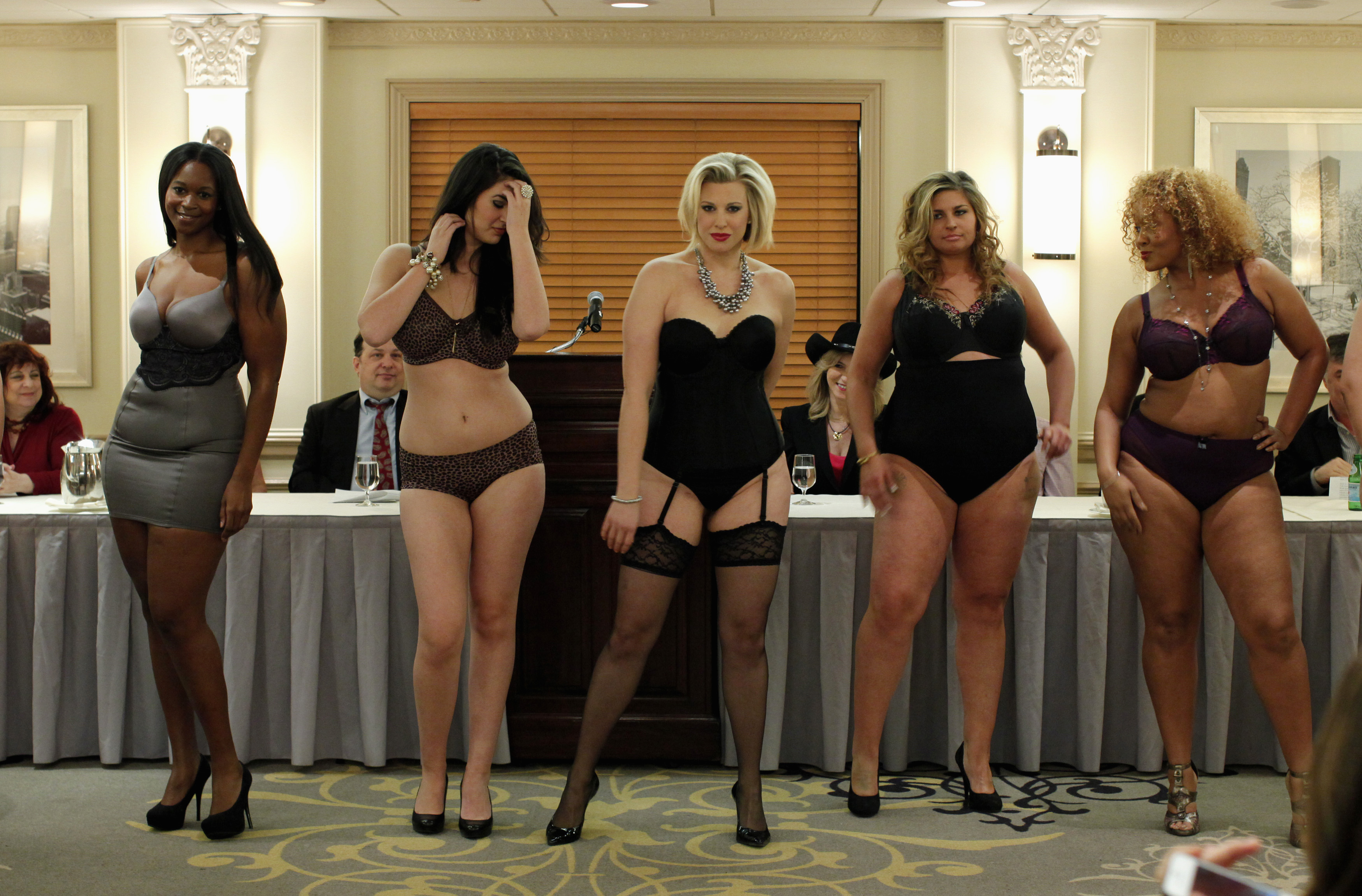 Models present creations from the the Curvy Fall/Winter 2012 collection show during New York Fashion Week