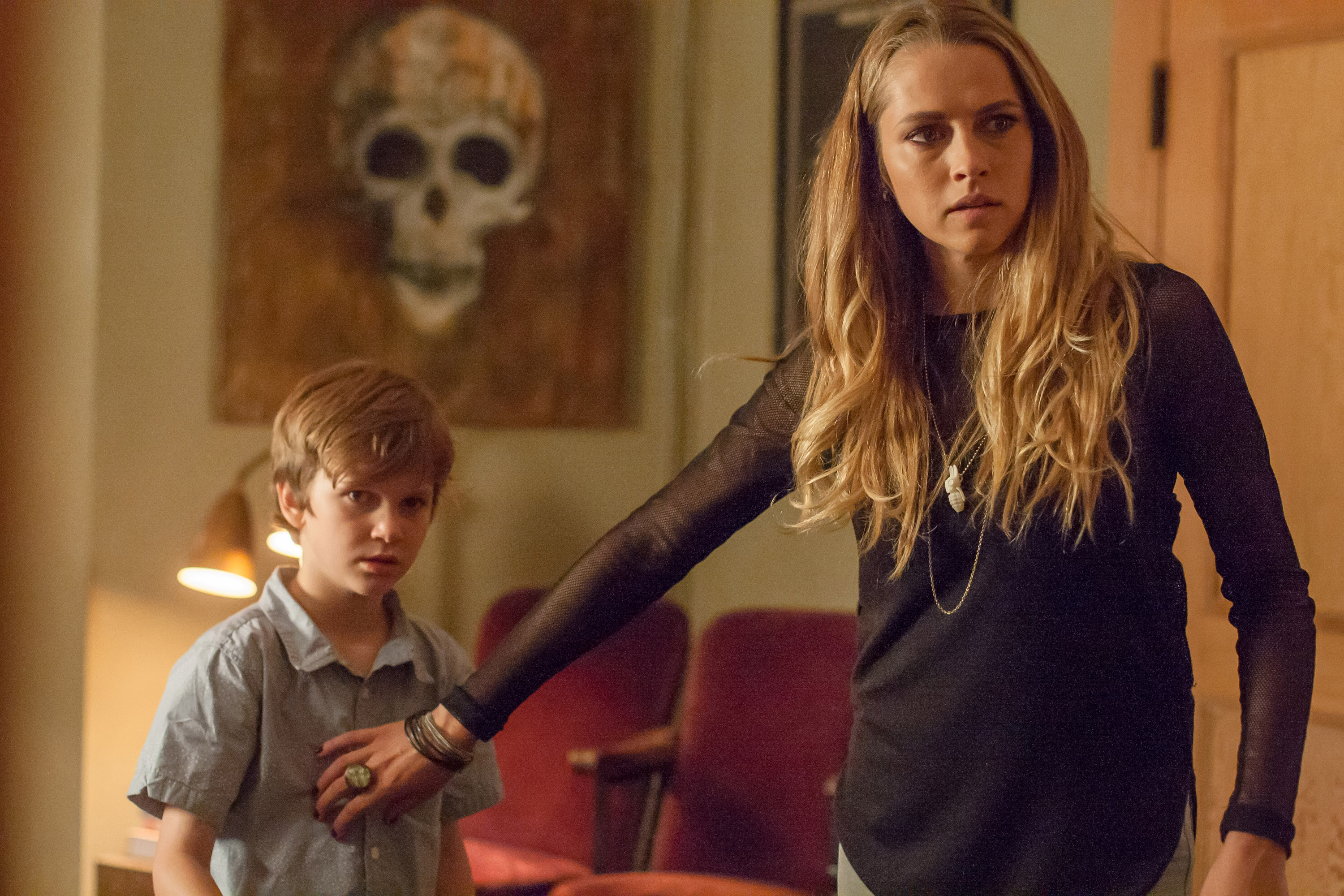 """In this image released by Warner Bros. Pictures, Gabriel Bateman, left, and Teresa Palmer appear in a scene from the horror film, """"Lights Out."""" (Ron Batzdorff/Warner Bros. Pictures via AP)"""