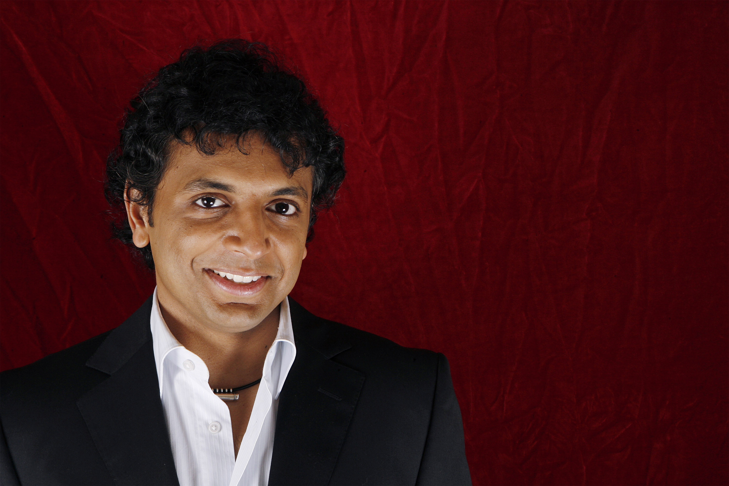 """Director M. Night Shyamalan poses for a portrait during a press day promoting his new film """"The Happening"""" in New York June 9, 2008. REUTERS/Lucas Jackson (UNITED STATES) - RTX6P8Q"""