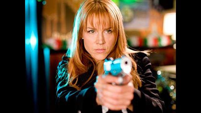 az egyetlen nő - nyilván fegyverrel